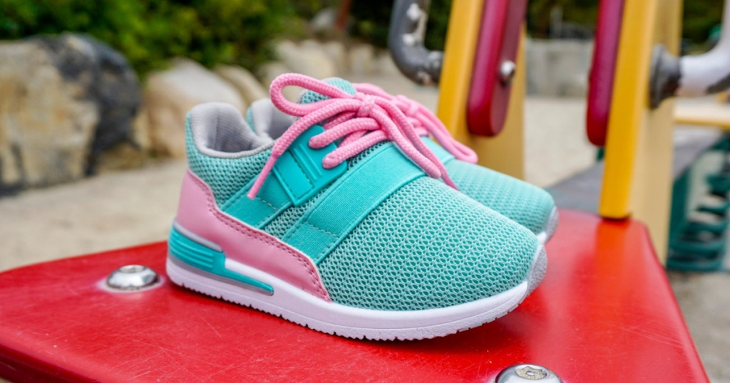 teal and pink toddlers athletic shoes sitting outside