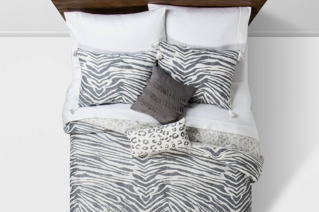 bed with comforter and pillows