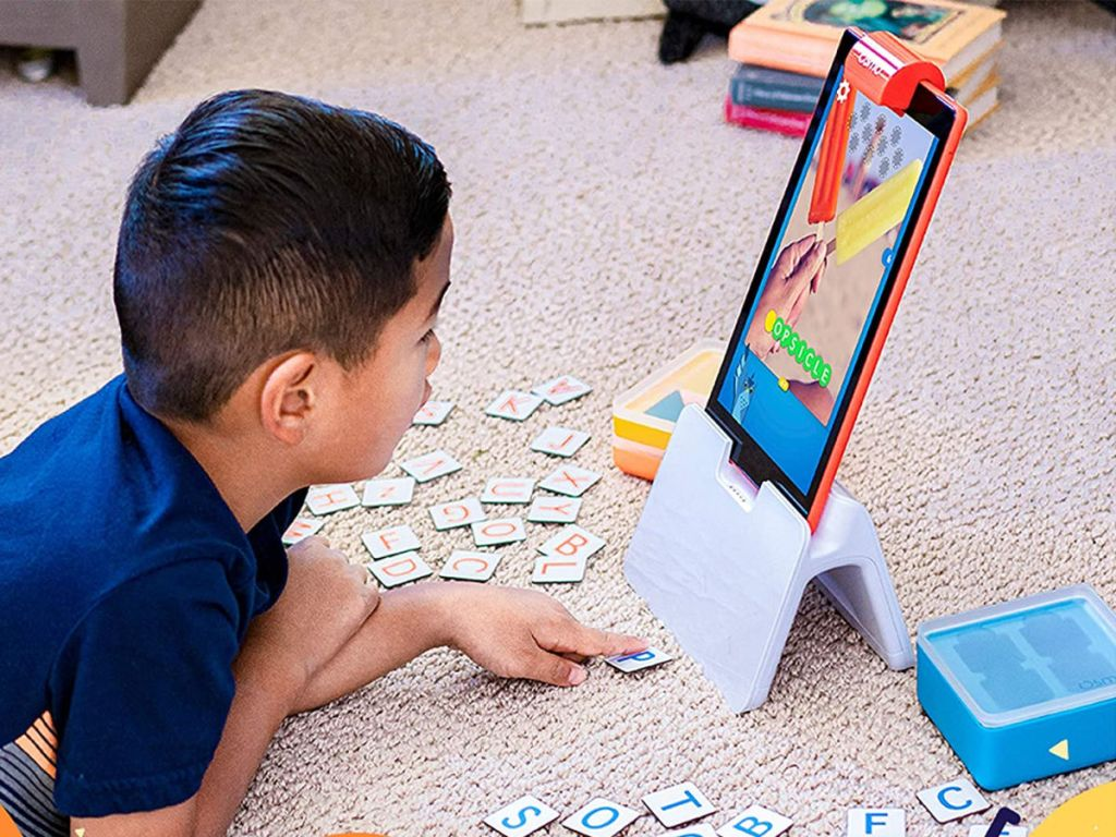 boy playing with Osmo Genius on Amazon Fire tablet