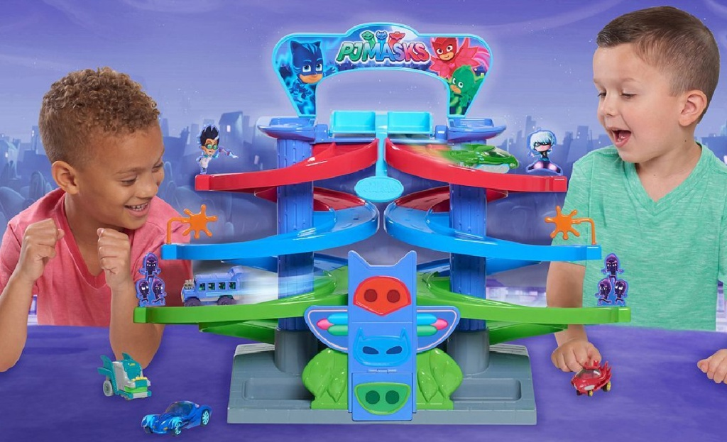 two boys playing with PJ masks playset