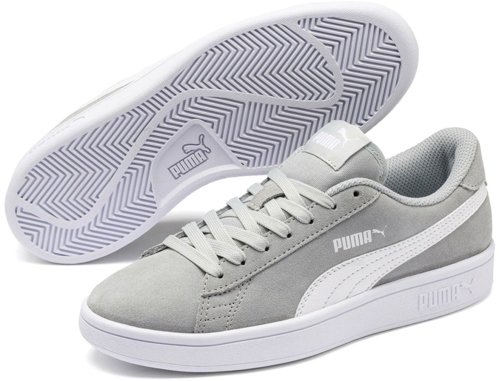 pair of light grey suede sneakers with white puma stripe on side