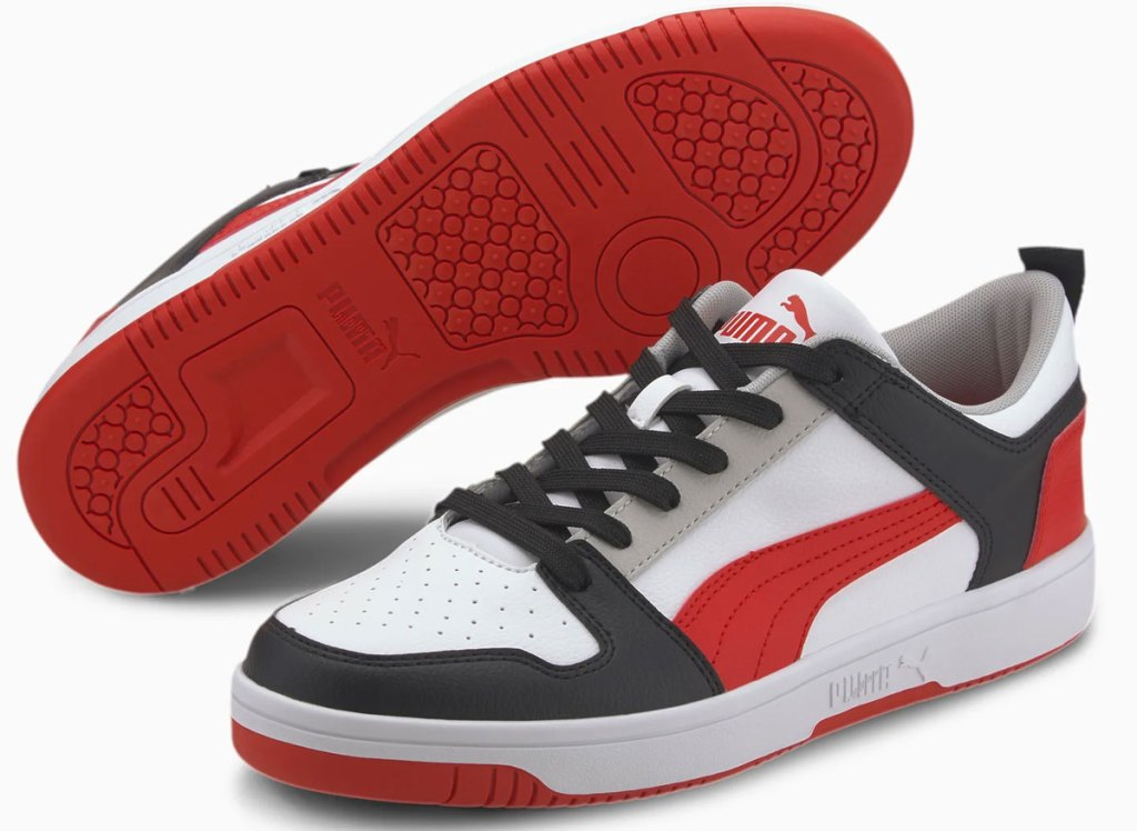pair of white, black, grey, and red men's puma sneakers