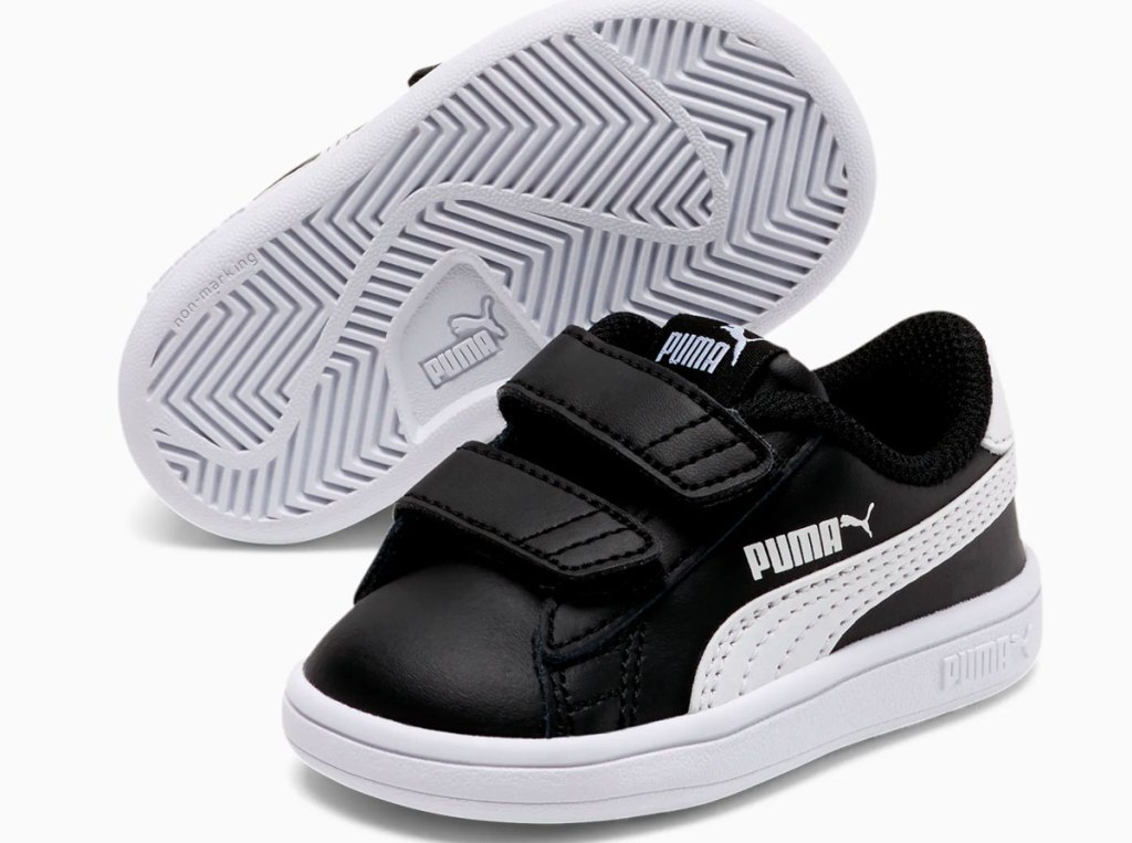 black leather todddler sneakers with velcro straps and white puma stripe down side