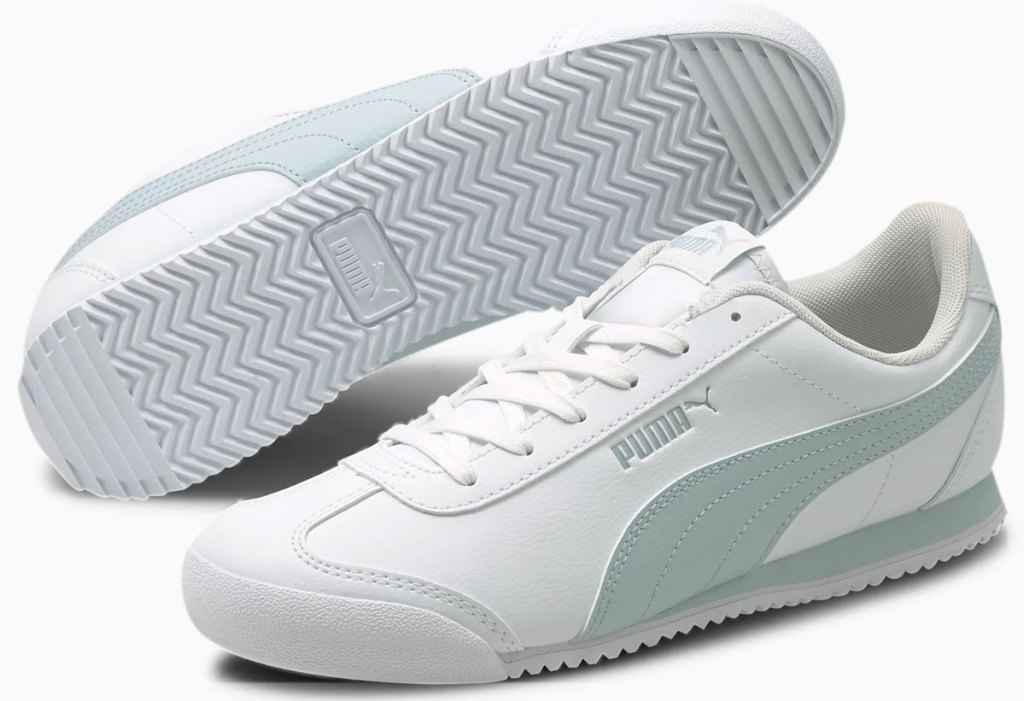 pair of white leather sneakers with light blue puma stripe on side