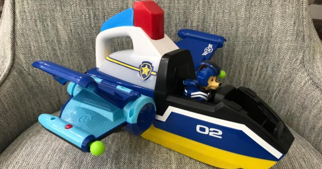 Paw Patrol jet toy on gray chair