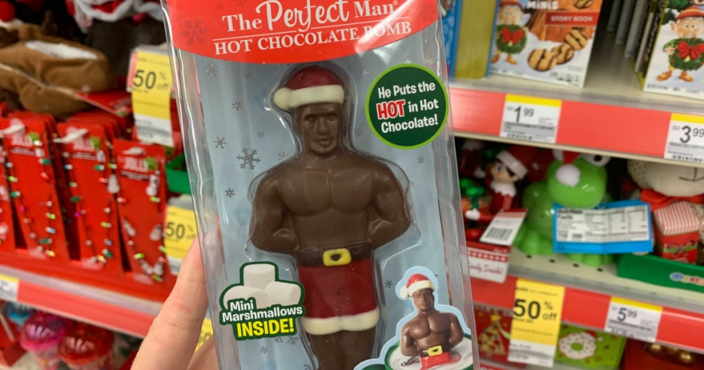 hand holding man-shaped hot chocolate bomb in store
