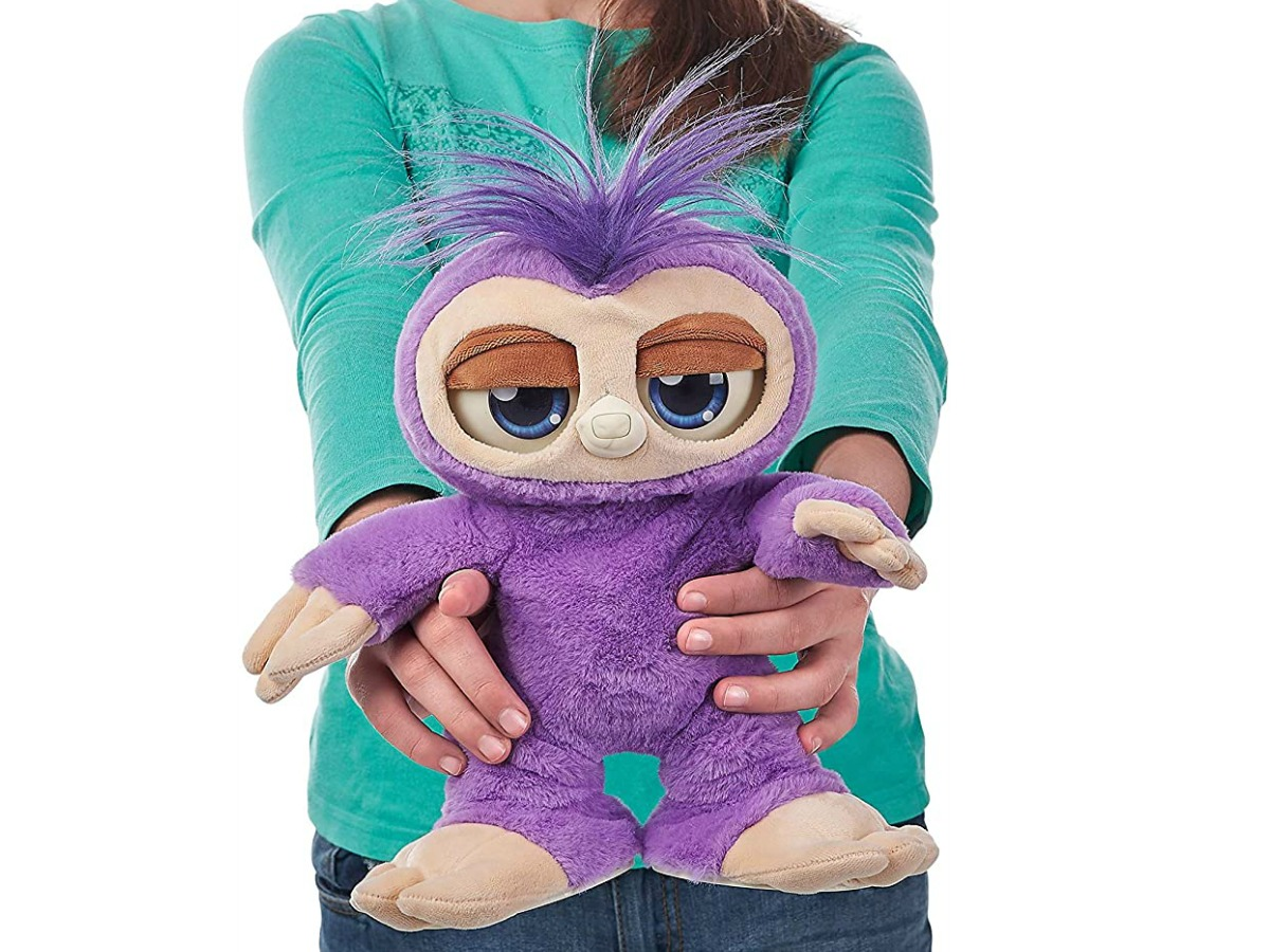 Girl holding Pets Alive Fifi the Flossing Sloth