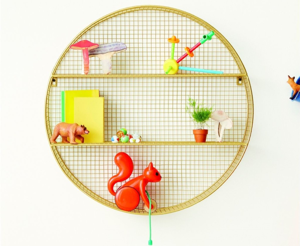 circle shelf with toys on it