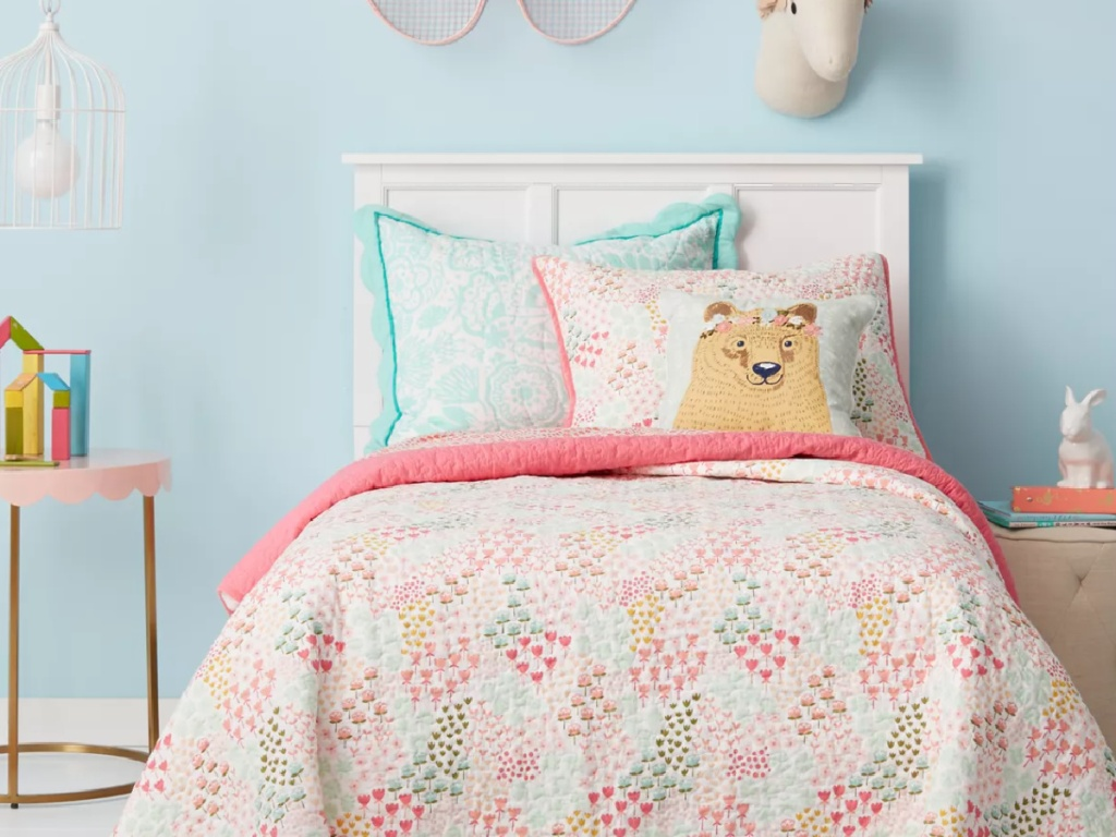 colorful child's room with a bear pillow on the bed