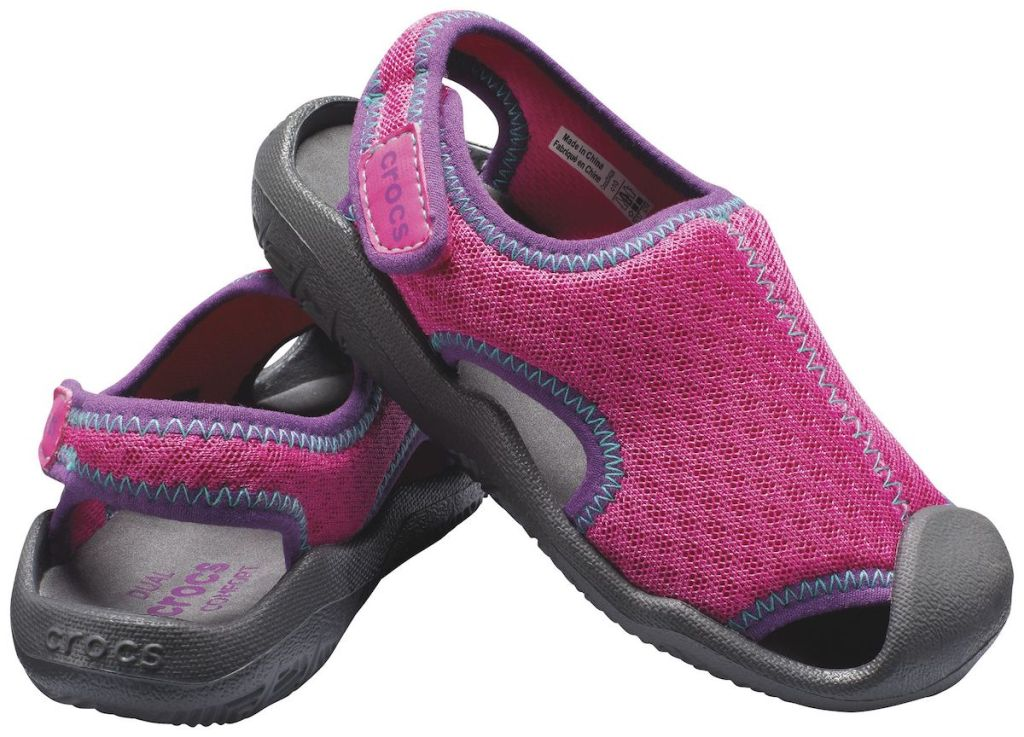 pink, purple, and blue colored Crocs Kids' Swiftwater Sandal