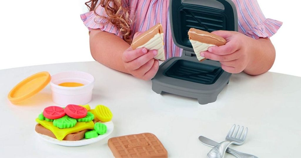 child playing with Play-Doh Cheesy Sandwich Maker Play Set