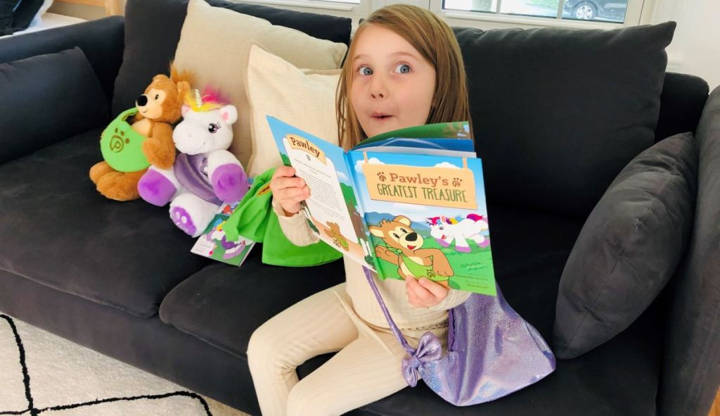 girl reading a book with a surprised look on her face