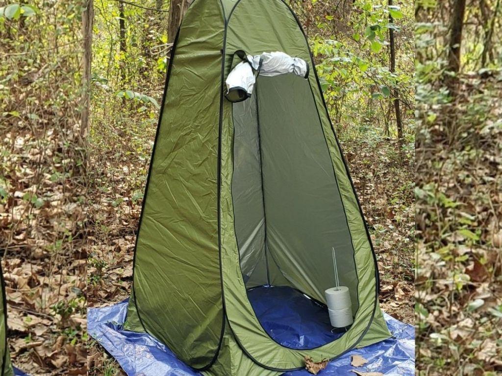 door opened on green popup tent in woods