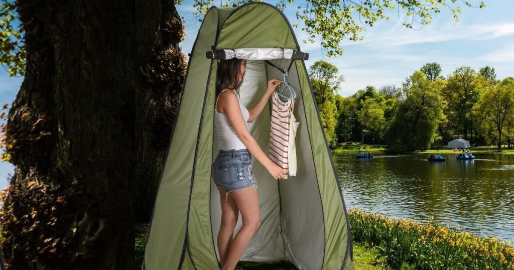 woman standing in popup privacy tent
