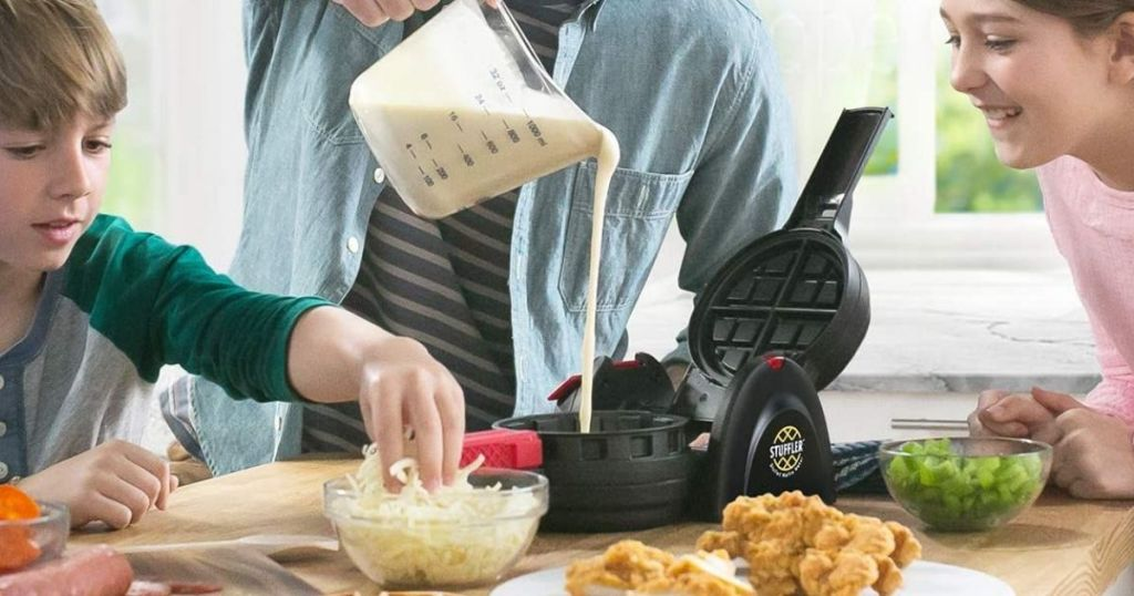 family making waffles with a waffle maker