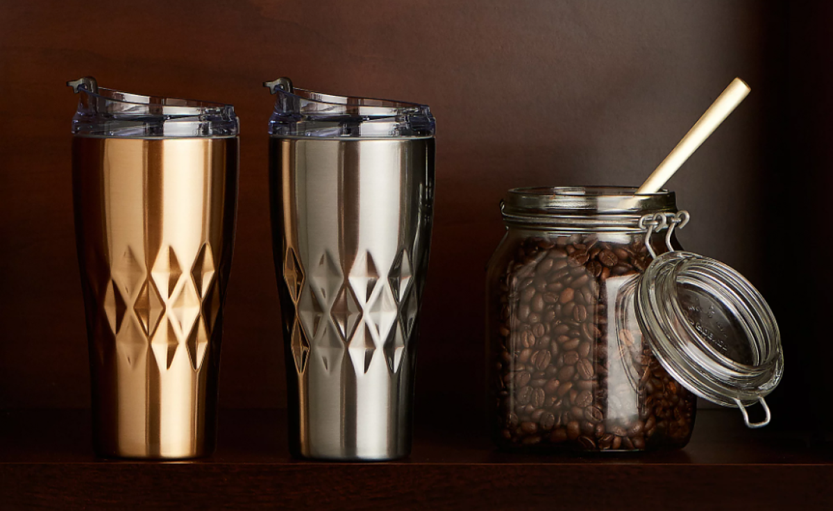two tumblers by a container of coffee