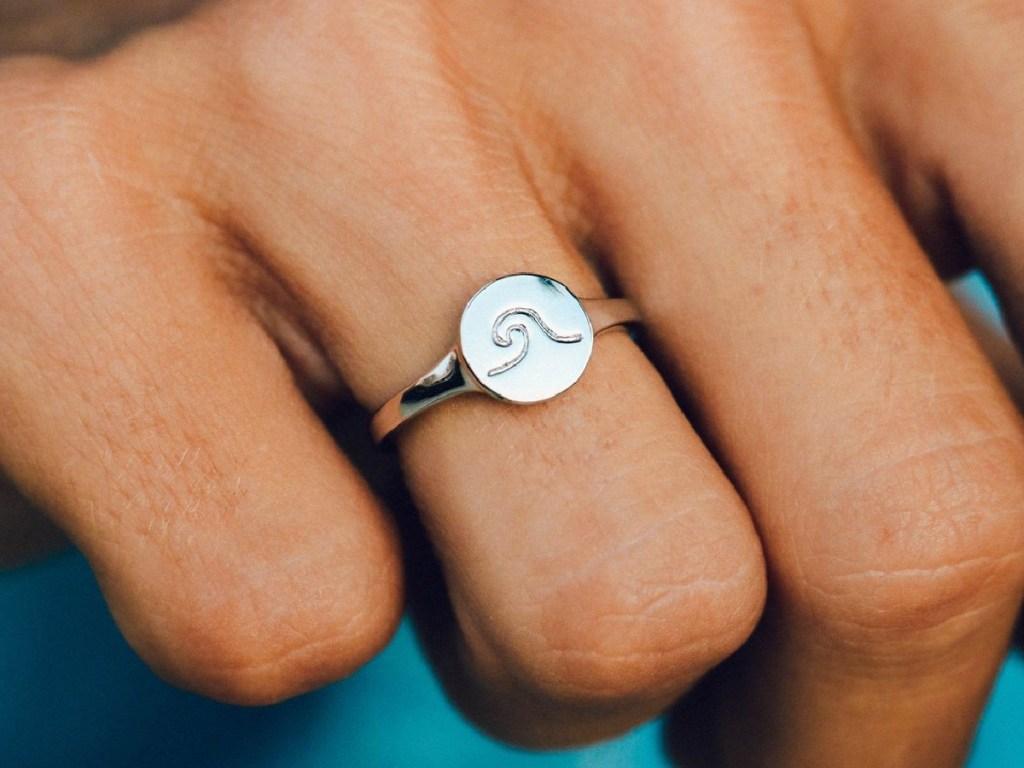 woman wearing wave ring