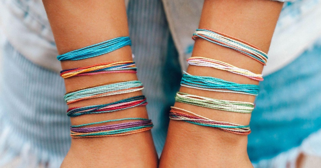 woman wearing pura vida bracelets on each arm
