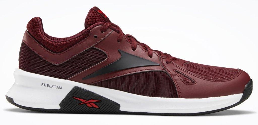 maroon sneakers with black reebok logo on the side