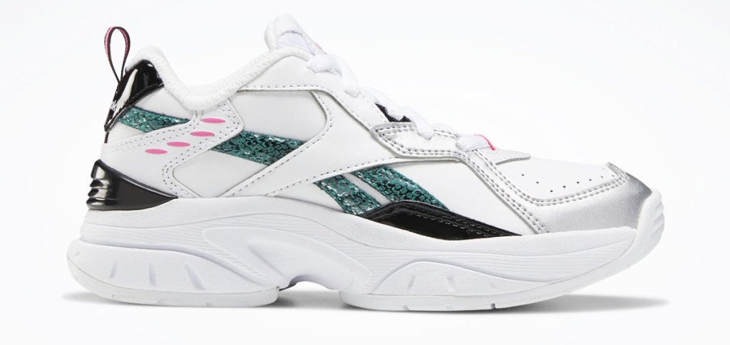 white toddler girl sneakers with white and glittery teal reebok logo on the side