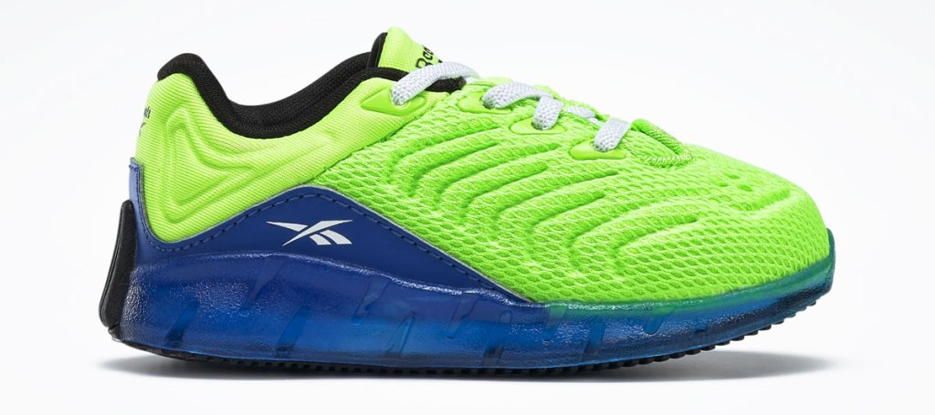 neon green toddler sneaker with blue rubber sole