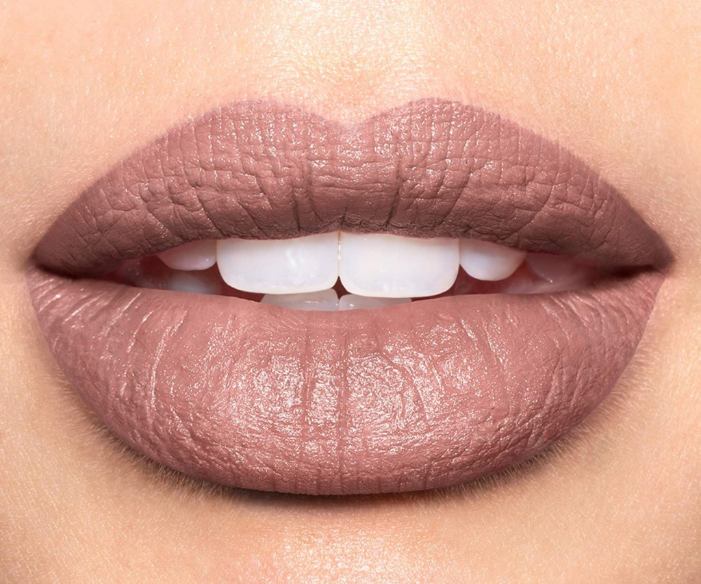 woman's lips with nude pink lipstick