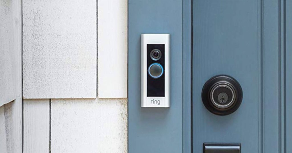 silver and black ring doorbell pro at blue front door of house