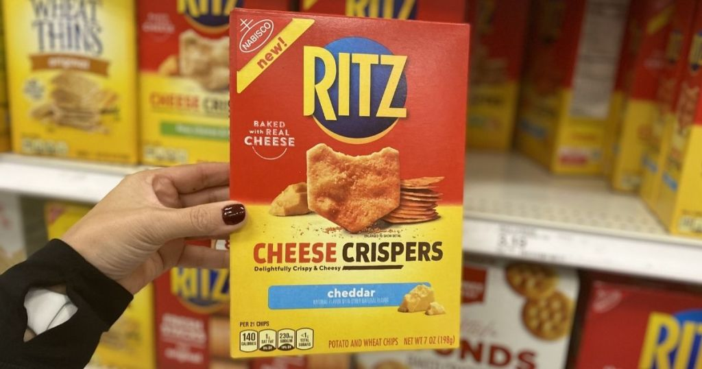 hand holding a box of Ritz Cheese Crispers