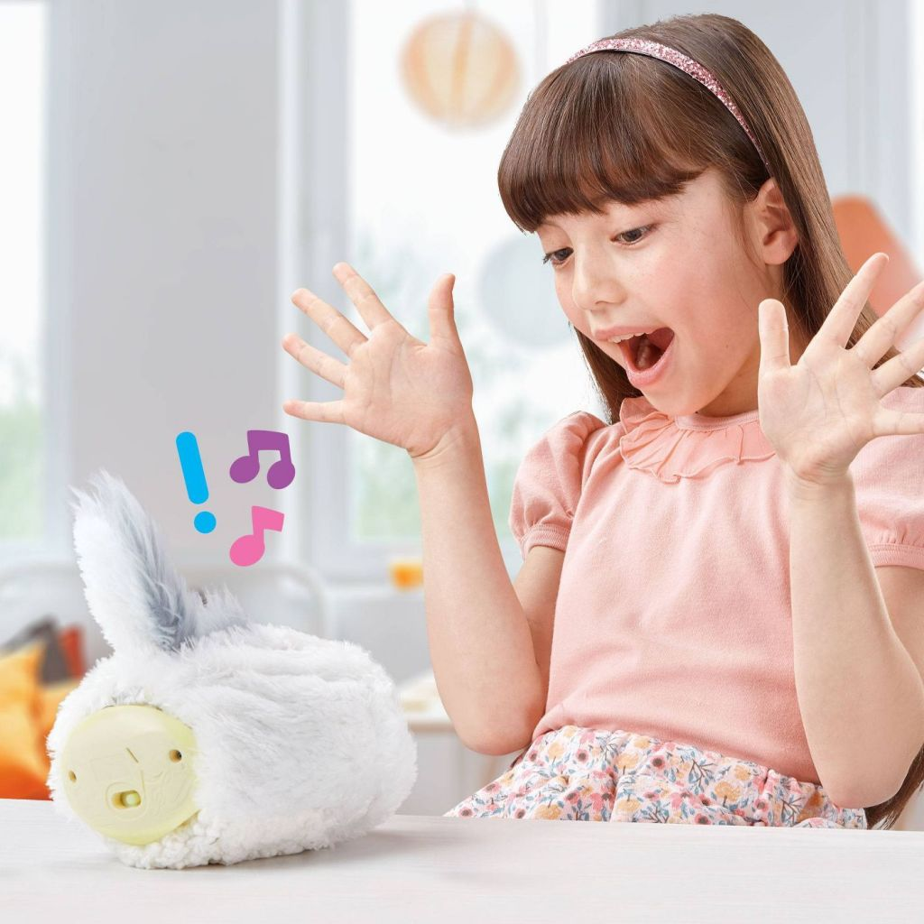 Little girl playing with Rizmo Interactive Gadget