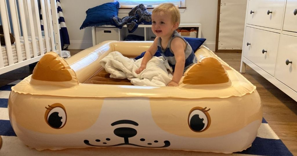 boy sitting on an inflatable bed