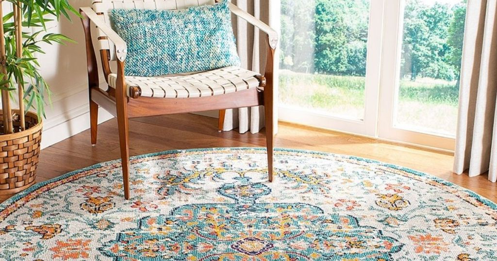 room with a chair and a rug on the floor