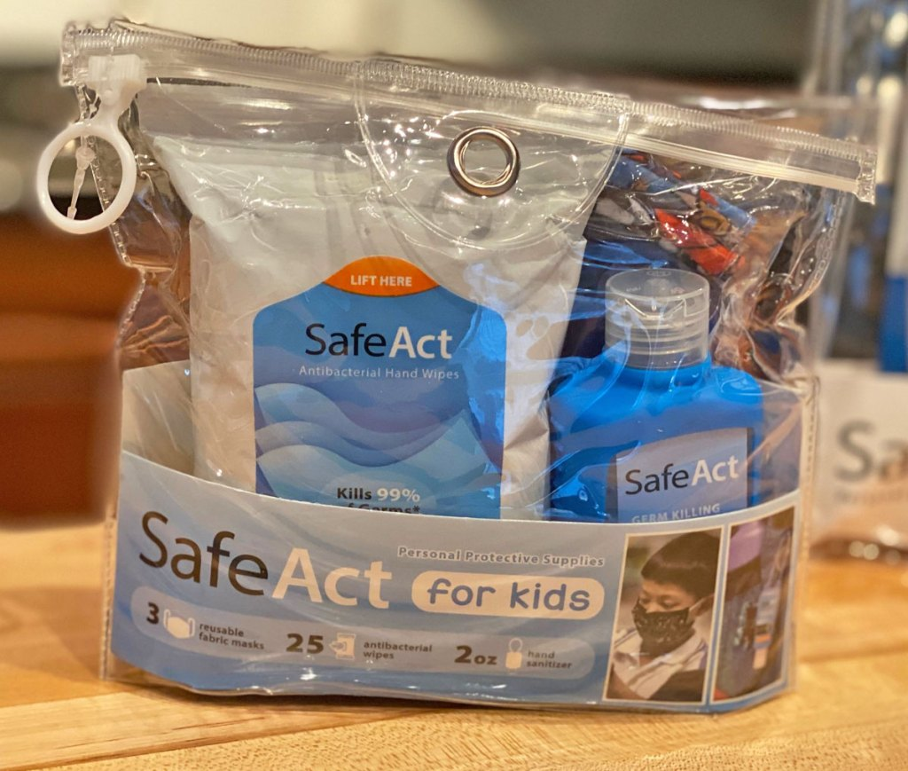 Clear resealable bag with SafeAct wipes, hand sanitizer, and face masks inside