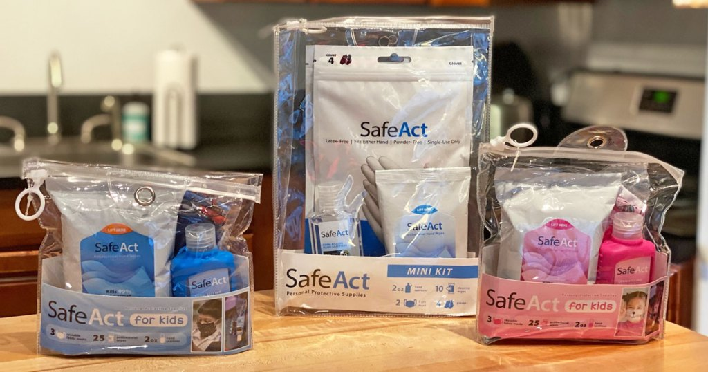 clear resealable bags with personal protective gear inside them on a wood table