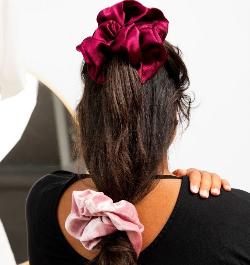 Girl wearing two jumbo scrunchies