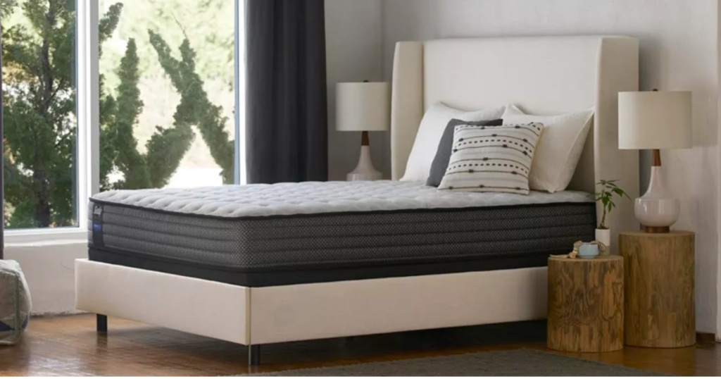 sealy mattress on top of a white box spring in a bed room
