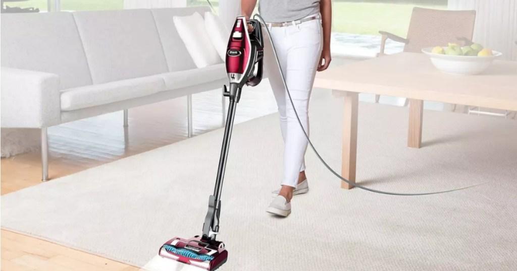 woman pushing Shark Rocket Vacuum