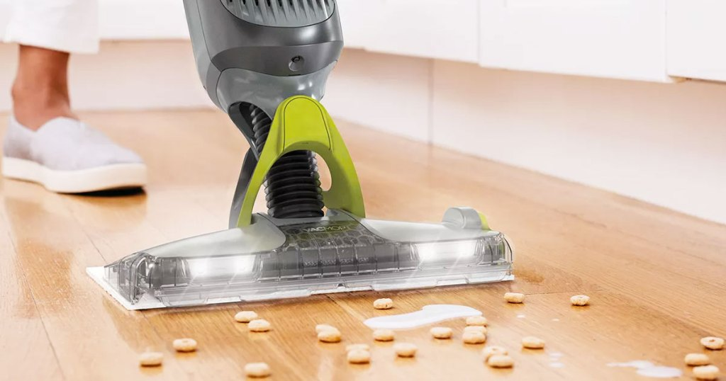 grey shark vacmop cleaning up spilled cereal and milk on hardwood floor