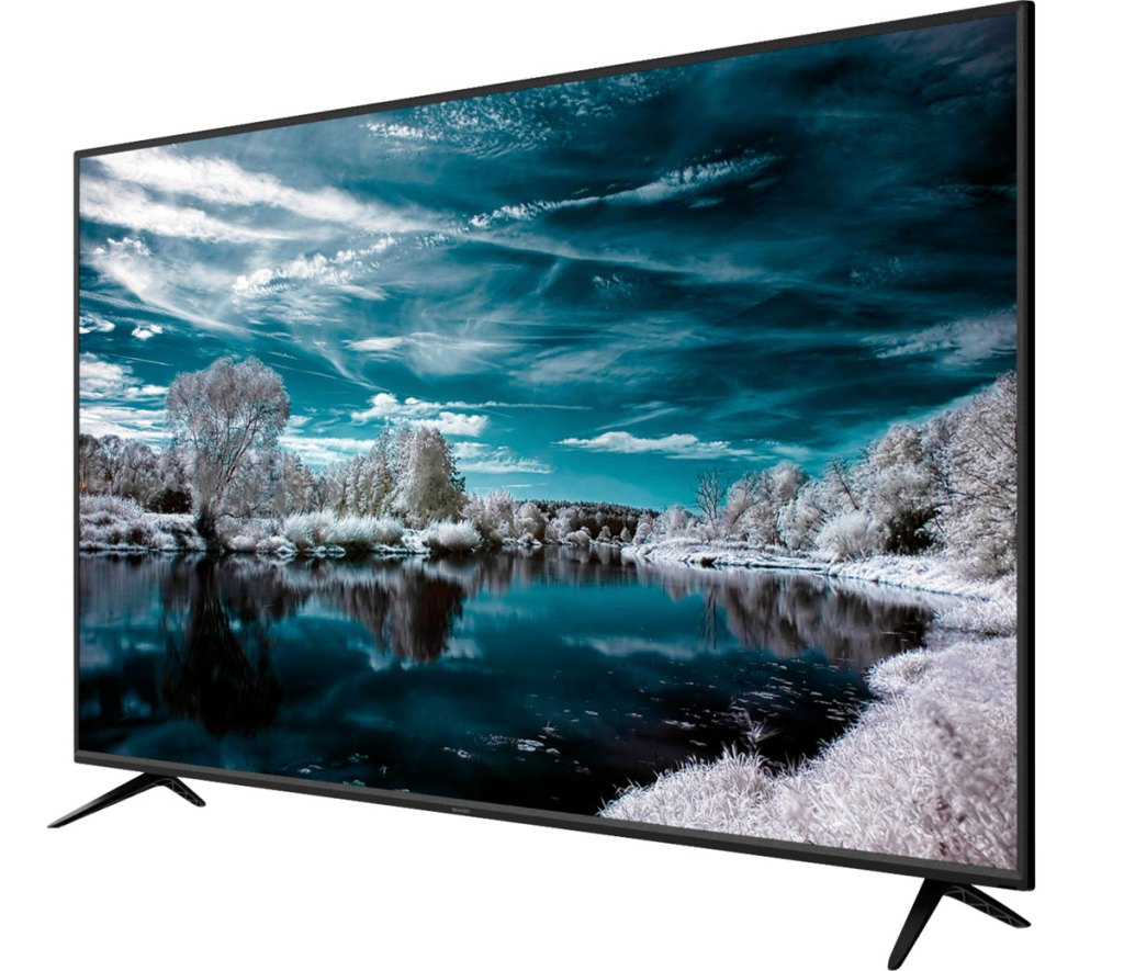 sharp flat screen smart tv showing blue and white snowy nature photo