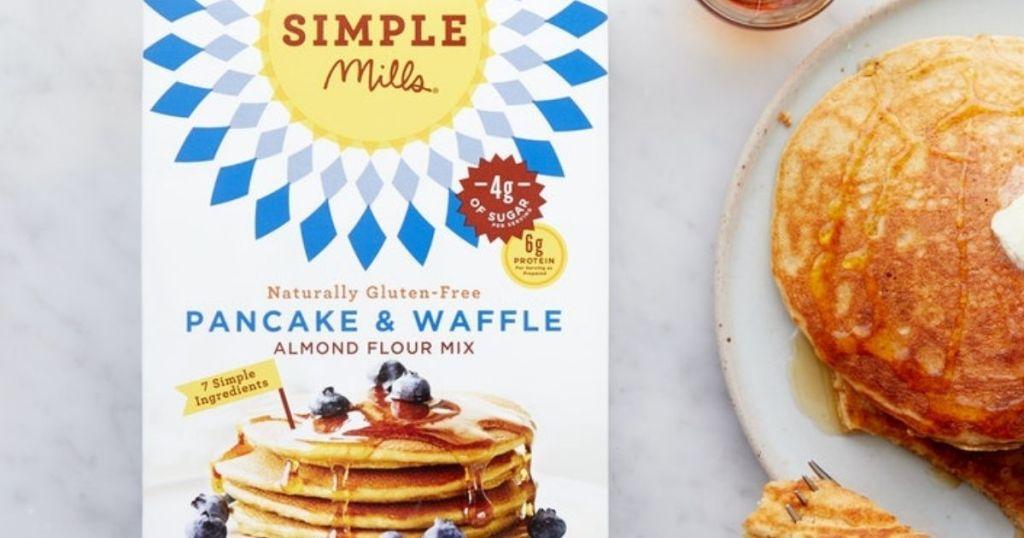 Simple Mills Pancake & Waffle Mix box next to pancakes on a plate