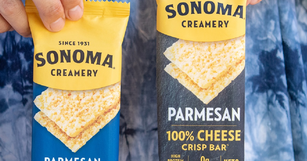 woman's hands holding two parmesan cheese crisp bars