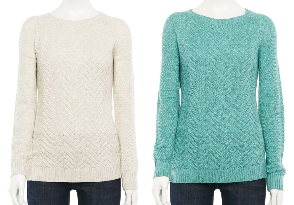 two mannequins with white and mint colored sweaters with a chevron print design