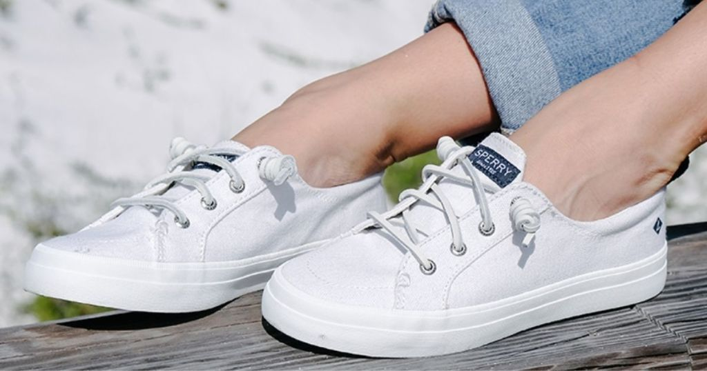 person wearing a pair of Sperry Sneakers