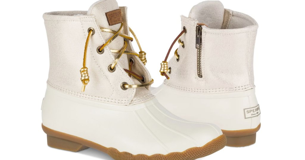 pair of women's white duck boots with gold leather laces