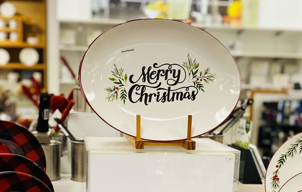 white oval shaped serving patter that says merry christmas