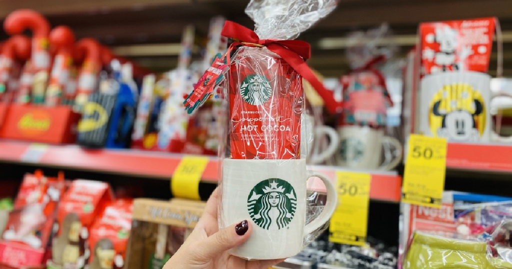 hand holding Starbucks mug and cocoa gift set in store