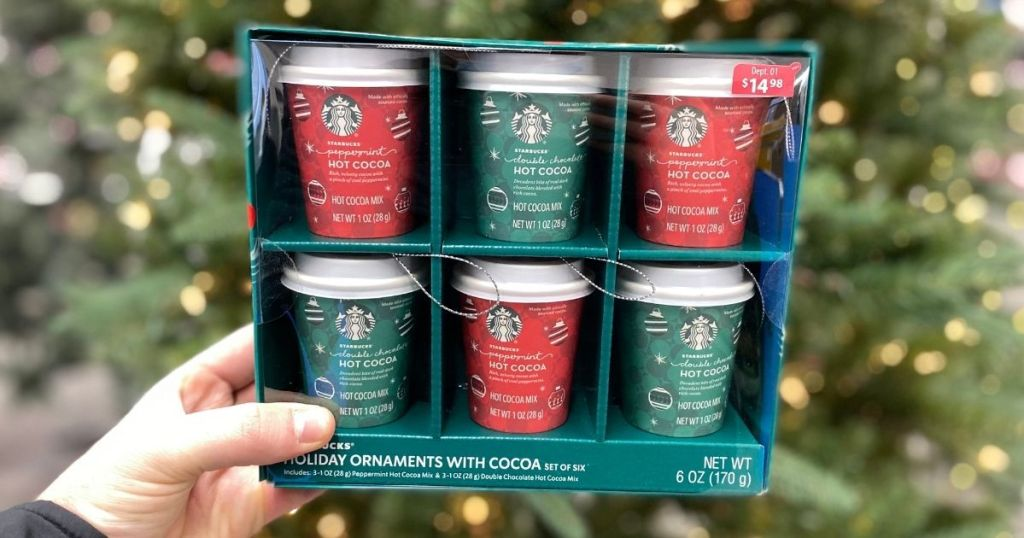 hand holding a package of Starbucks ornaments cups