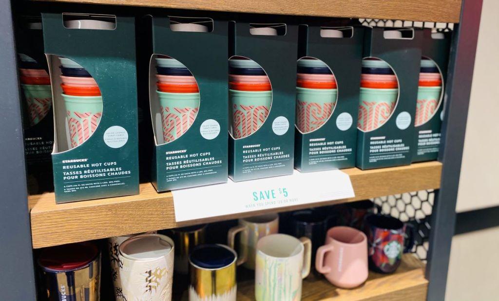 display of Starbucks tumblers on a shelf