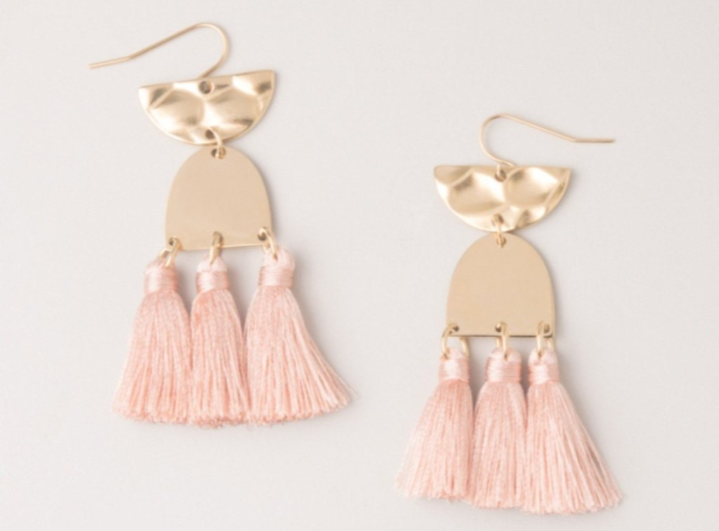 pair of gold and pink earrings