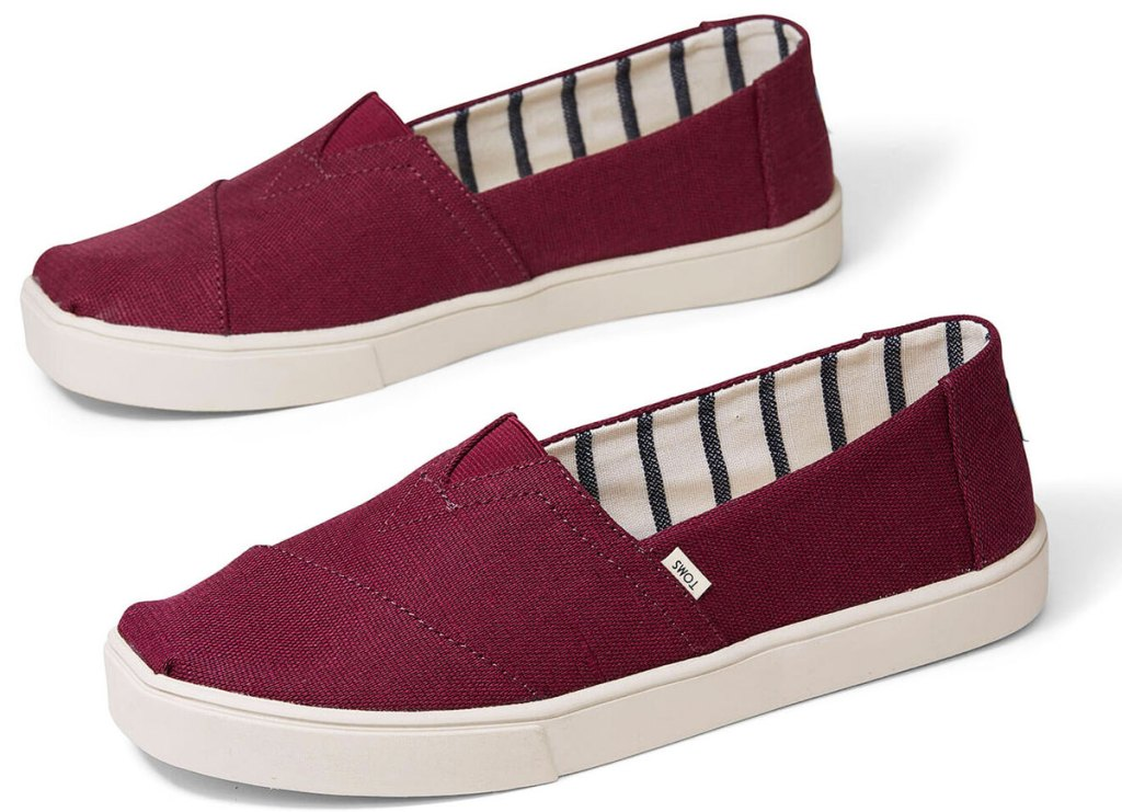 pair of burgundy colored canvas toms slip-on shoes