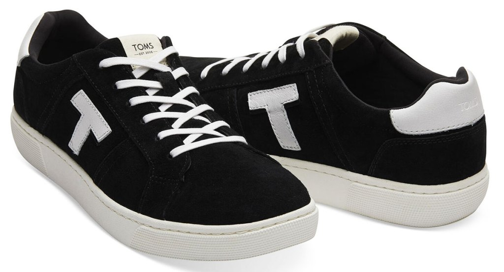 black sneakers with white T on the sides with white laces and rubber soles